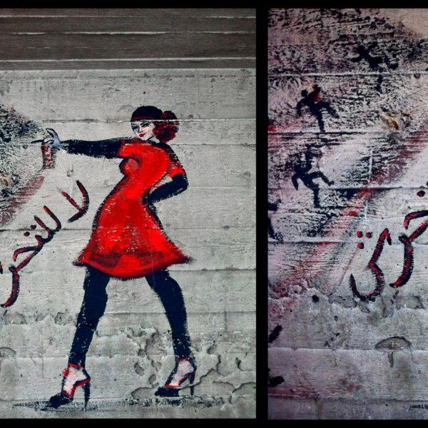 Väggmålning med kvinna i rött som sprayar med en sprayburk.