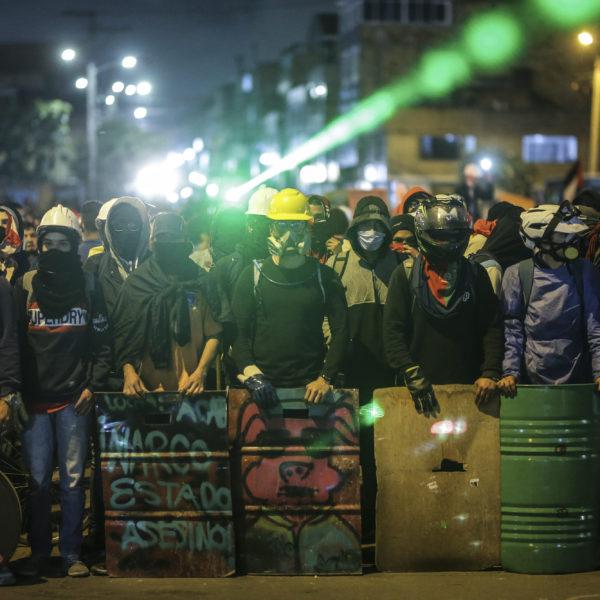 Demonstranter i Bogota under en antiregeringsmarsch på torsdagen.