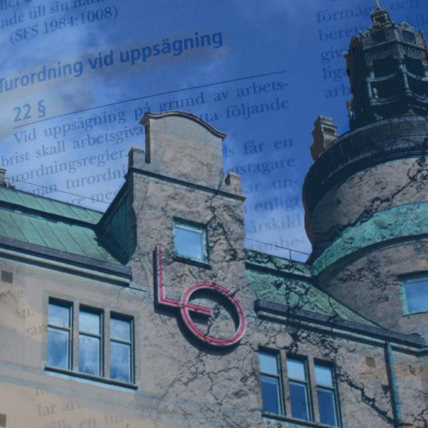 LO-borgen mot en blå himmel, tillsammans med lagtexten i lagen om anställningsskydd.